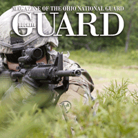 Video cover featuring close up o f soldier aiming gun through the grass.