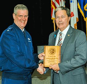 Maj. Gen. Mark E. Bartman presents a plaque of appreciation to Dr. Robert L. Boggs, deputy director, People and Culture Directorate, Defense Logistics Agency Land and Maritime.