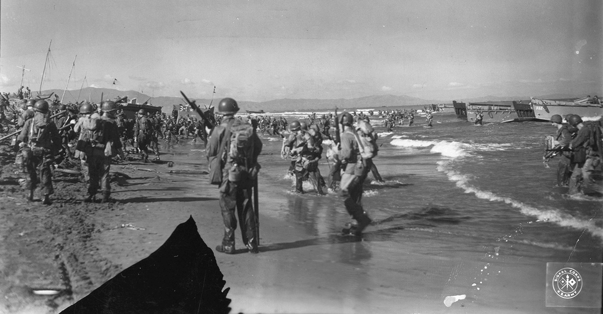 Soldiers, guns and equipment pour ashore.
