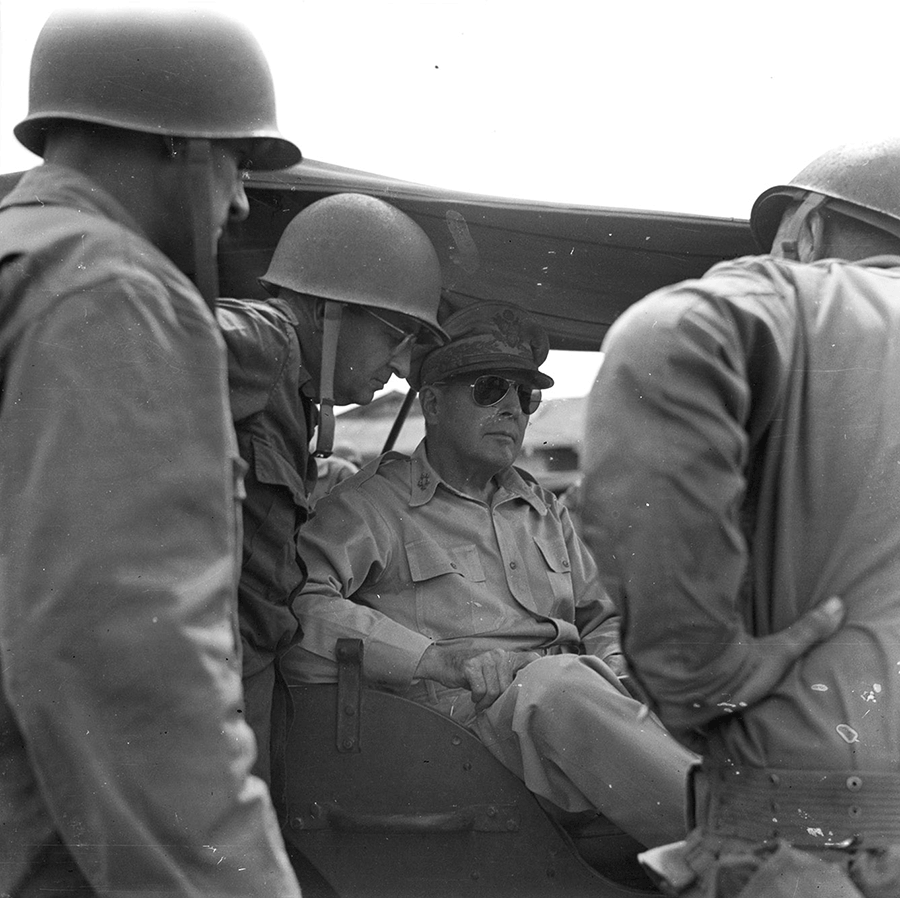 Maj. Gen. Robert S. Beightler discusses the division's operations with General in vehicle.