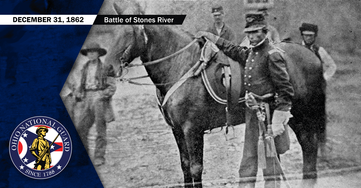 Black and white photo of  Soldier in uniform standing by horse.