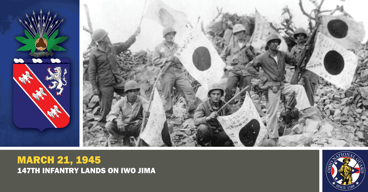 Members of Company A, 147th Infantry, proudly display Japanese flags.