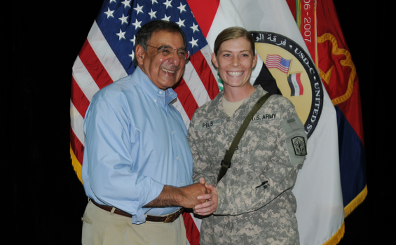 Ohio Army National Guard Staff Sgt. Kelly Ann Pels, of Headquarters and Headquarters Battery, 1st Battalion, 174th Air Defense Artillery Regiment and a Cincinnati, Ohio, resident, meets U.S. Defense Secretary Leon Panetta July 11, 2011