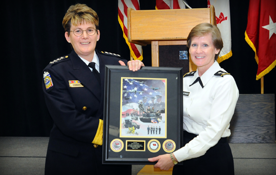 Maj. Gen. Deborah A. Ashenhurst (right), Ohio adjutant general, presents Columbus Police Chief Kim Jacobs with a commemorative Ohio National Guard print