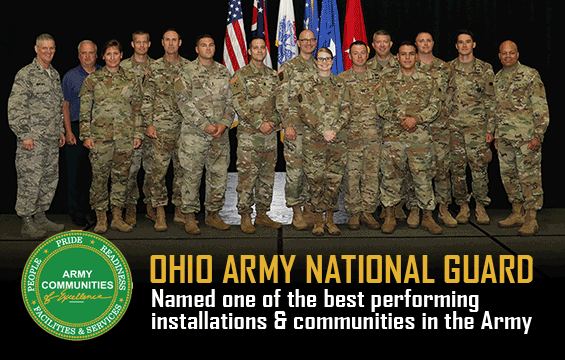 Ohio National Guard members affiliated with award, stand on stage to be recognized.