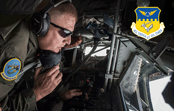 closeup of boom operator with chin in harness operating the joystick onn on a C-130H.