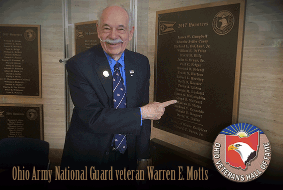 Warren Motts points to his name on the 2017 Honorees plaque