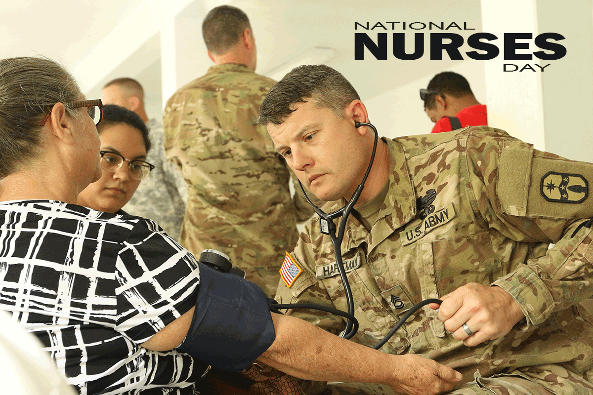 Male Soldier/Nurse takes blood pressure of female civilian.
