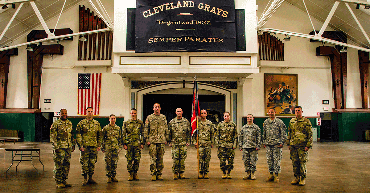Members of the 112th Engineer Battalion stand for a photograph on the drill floor.
