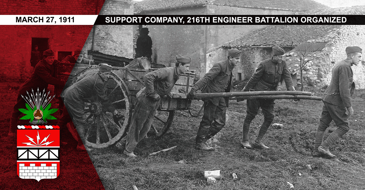 Men of Battery D pull a cart while doing salvage work.
