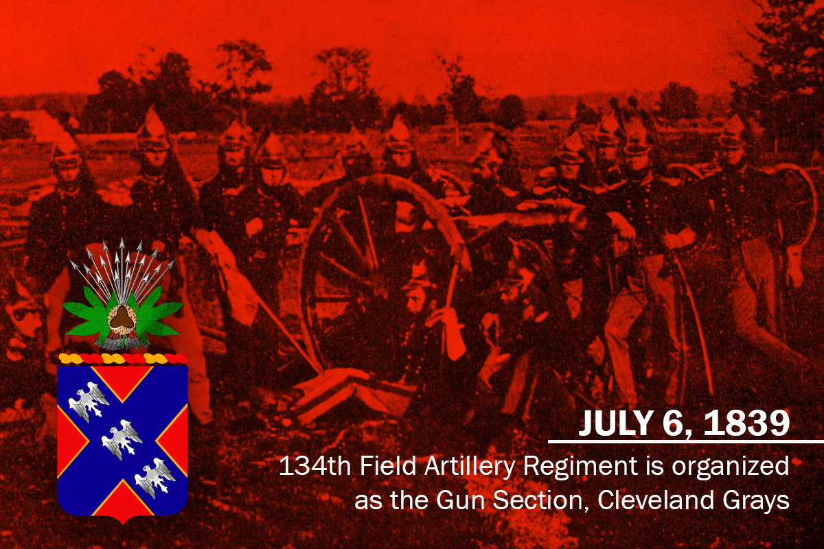 Soldiers stand around canon. Graphic displkays insignia and reads: JULY 6, 1839, 134th Field Artillery Regiment is organized as the Gun Section, Cleveland Grays