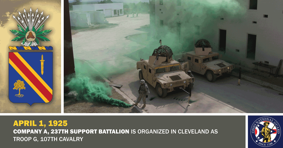 Soldiers deploy green smoke screen for humvees on street.