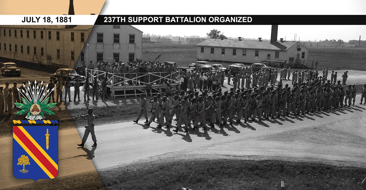 Company A, 372nd Infantry Battalion marches past the reviewing stand at Camp Atterbury, Ind., circa 1950