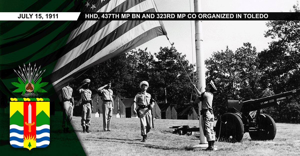 1977 photo of military policemen lowering the American flag.