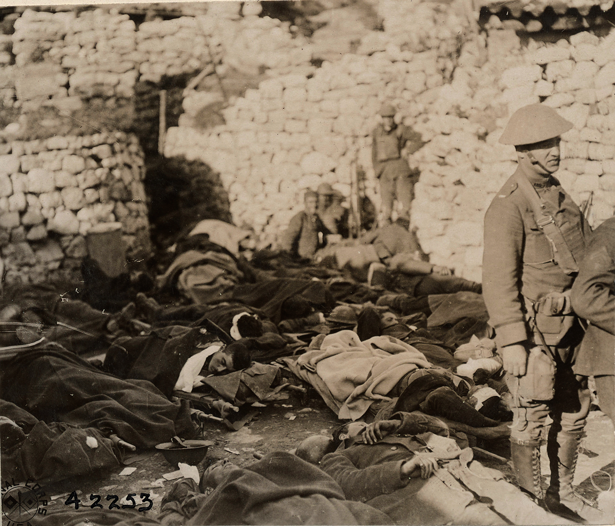 Sepia tone of Soldiers sleeping under blankets on ground
