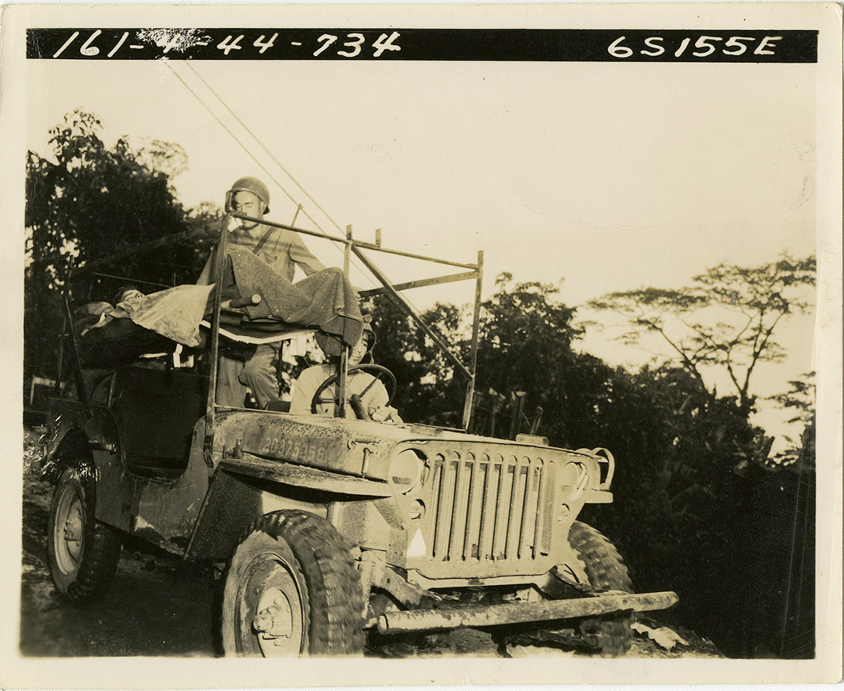 Sepia tone of Soldier in jeep