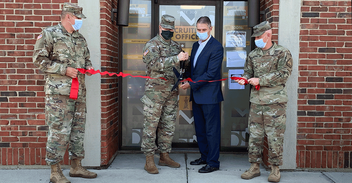 Col. Daniel Shank and Vandalia Mayor Richard Herbst cut a red ribbonin front of doors.