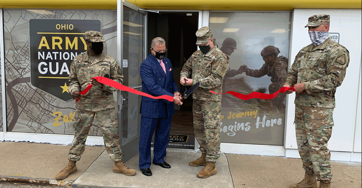Col. Daniel Shank and Zanesville Mayor Don Mason cut the ribbon to open the new Ohio Army National Guard storefront.