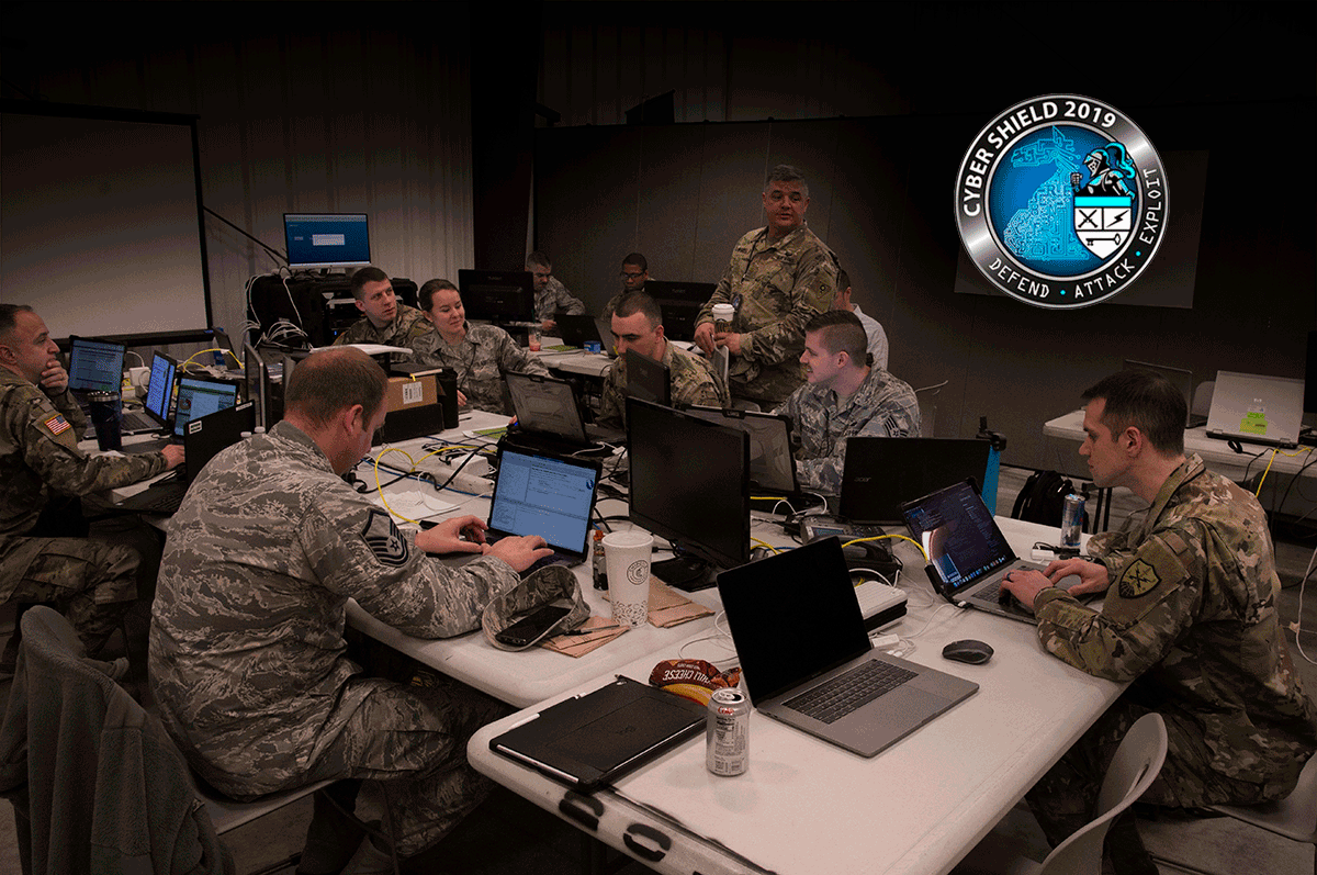 A team of 10 Ohio National Guard cyber warriors sit in classroom with laptops at tables to participate in a pilot program.