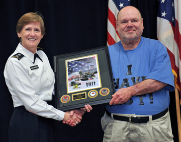 Maj. Gen. Deborah A. Ashenhurst (left), Ohio adjutant general, presents Hank Downs, a survivor of Military Sexual Trauma (MST), with a commemorative Ohio National Guard print