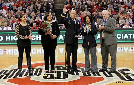 Maj. Gen. John C. Harris Jr., (center), Ohio assistant adjutant general for Army, receives the Ohio High School Athletic Association's Sportsmanship, Ethics and Integrity award during the Boys Basketball Division I state championship game.
