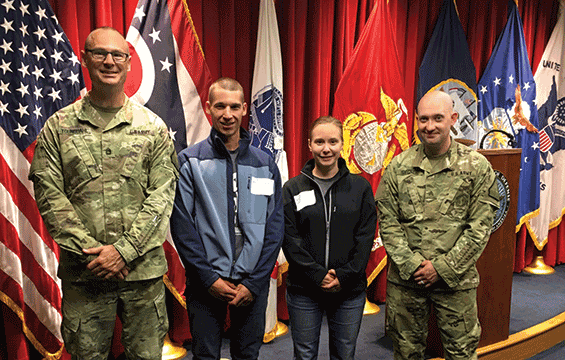 Nate and Irene Miller, husband and wife, pose with recruiters Sgt. 1st Class James Youngdahl (left) and Sgt. Noah Siegner after enlisting together into the Ohio Army National Guard.