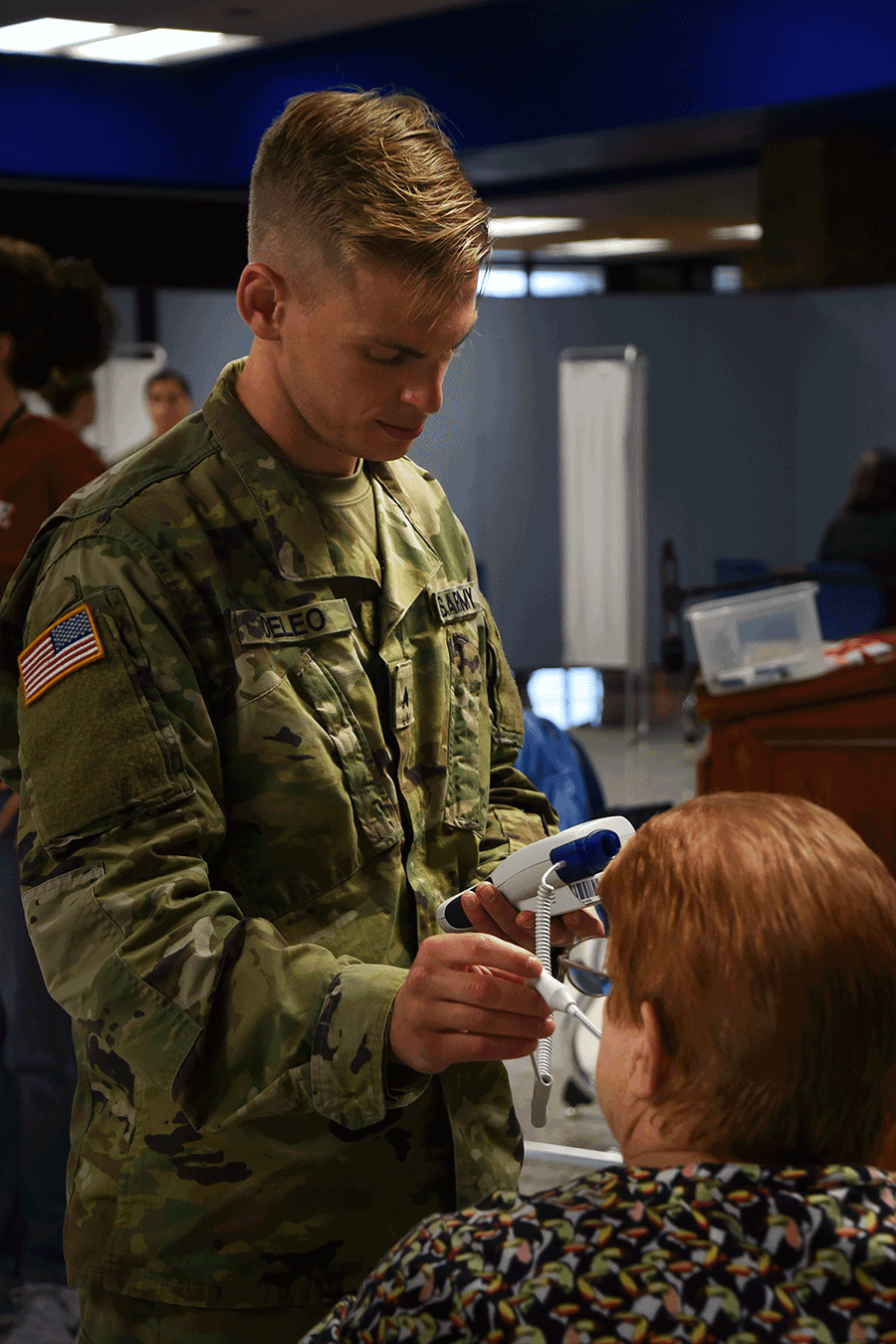 An Ohio Army National Guard health care specialist takes a patient's vitals.