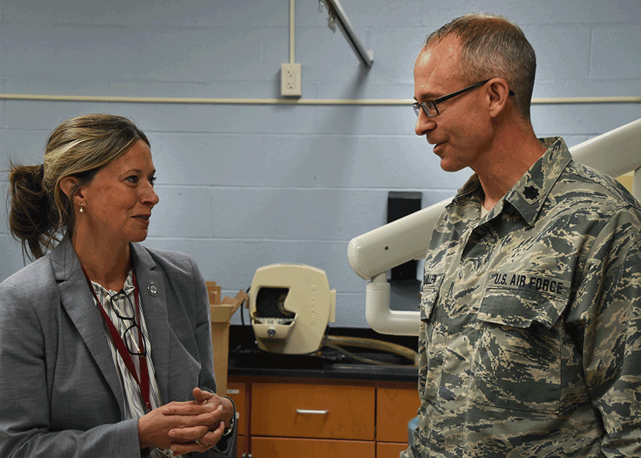 Dr. Amy Acton talking with Lt. Col. Timothy Stuhlmiller.