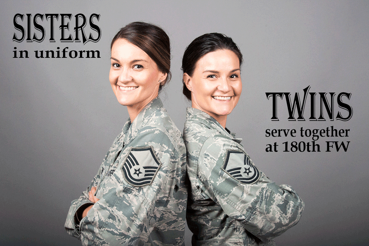 Twin Airmen sit back to back.