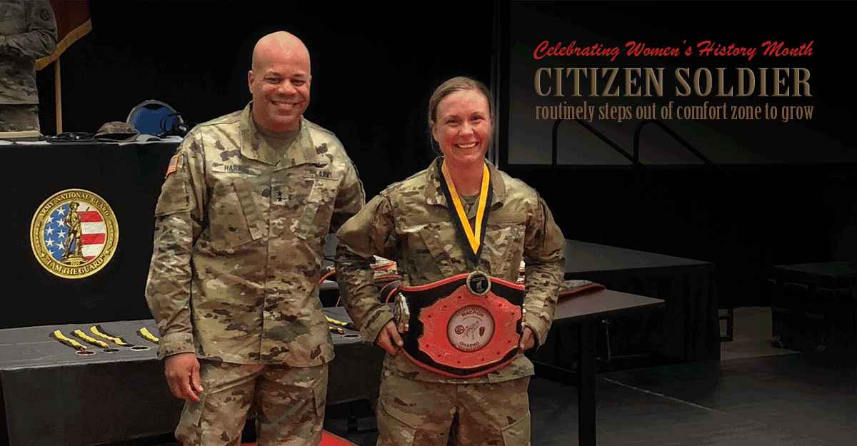 Stearns poses with Maj. Gen. Harris while displaying her belt