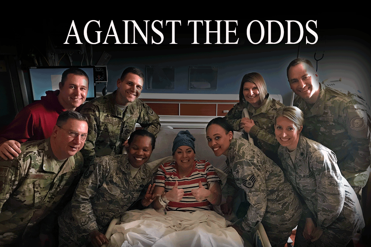 Airmen gather around Ortiz in her hospital bed. Headline reads: AGAINST THE ODDS