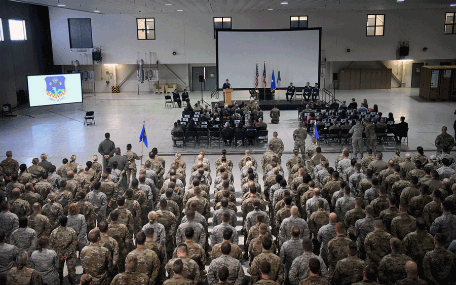 Change of command ceremony viewed from the back of the hangar.