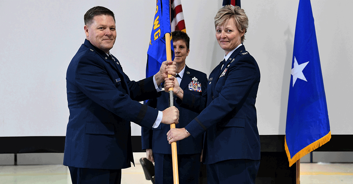 Brig. Gen. James R. Camp hands the guidon to Col. Kimberly A. Fitzgerald.