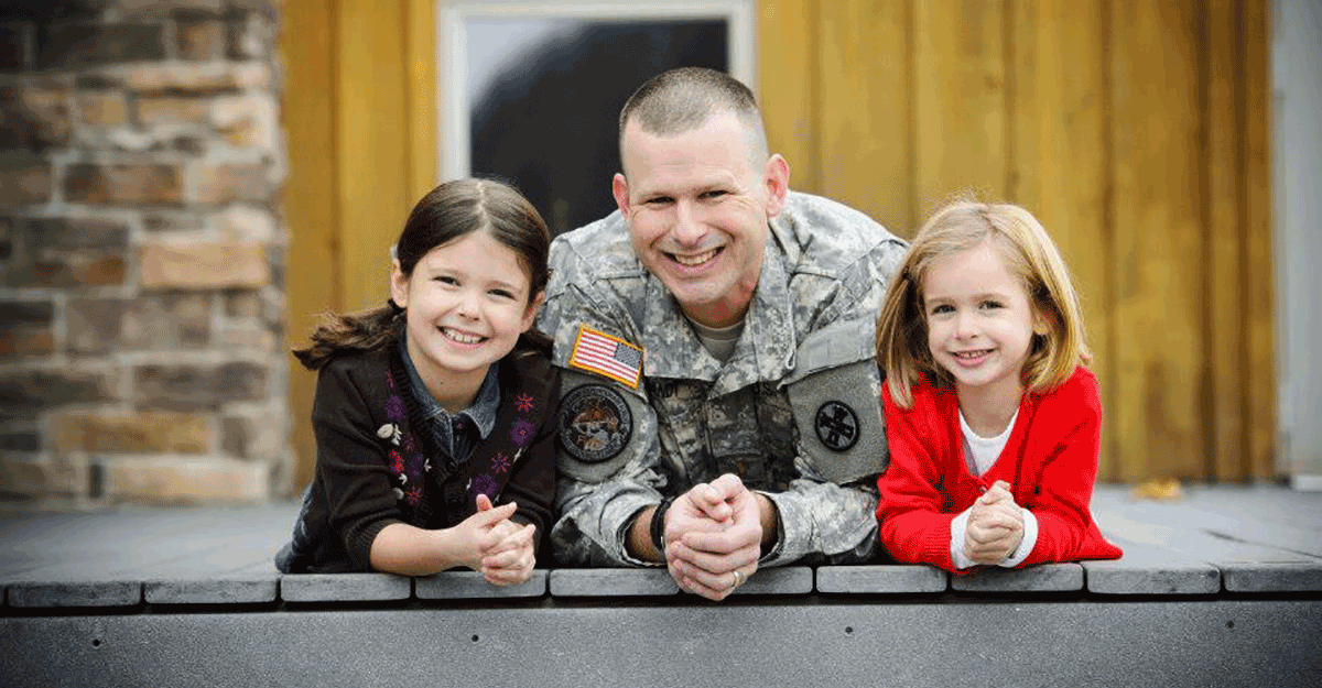 Brandt in uniform with young daughters.