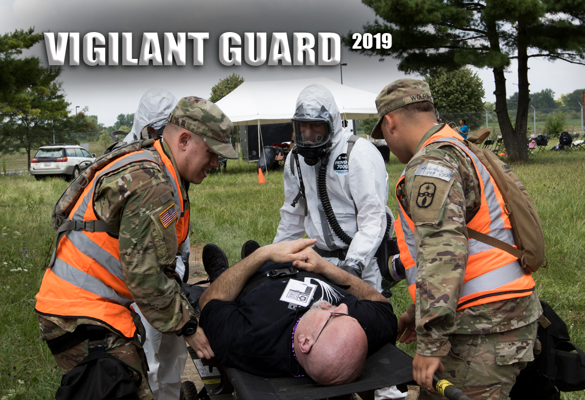 Soldiers prepare a simulated casualty for evacuation in field.