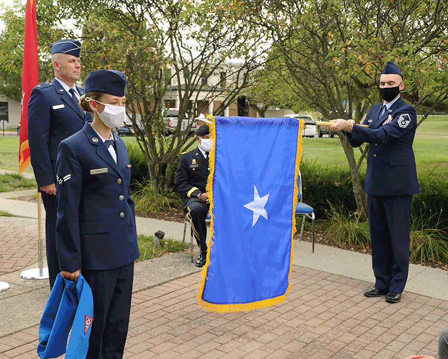 Newly promoted Brig. Gen. Gary McCue stands at attention at the unveiling of his Air Force one-star flag .