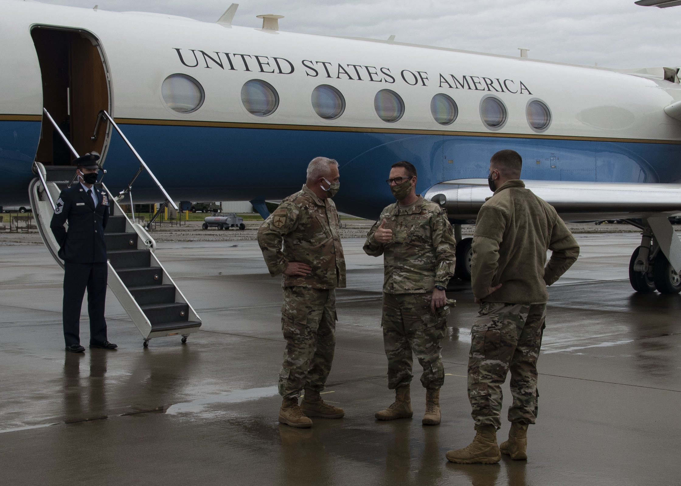 Gen. Joseph Lengyel talks with Airmen on tarmak of plane.