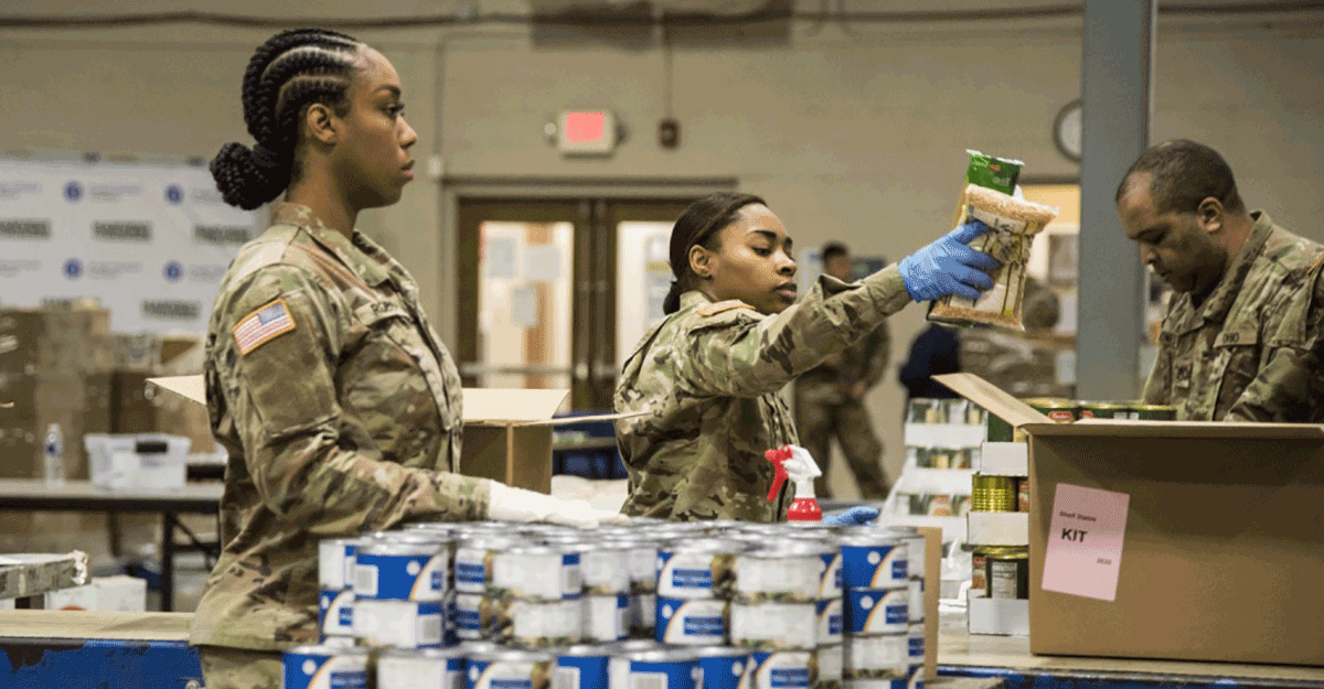 Soldiers load boxes at food bank