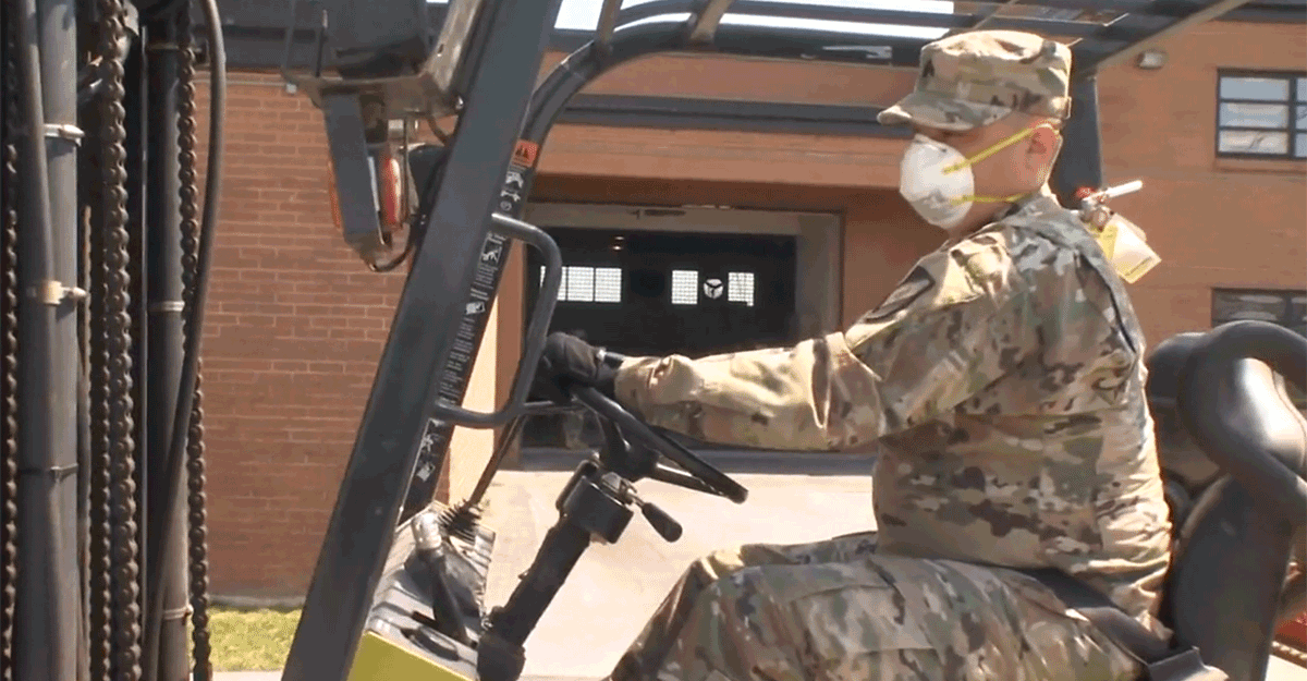 Soldier on forklift