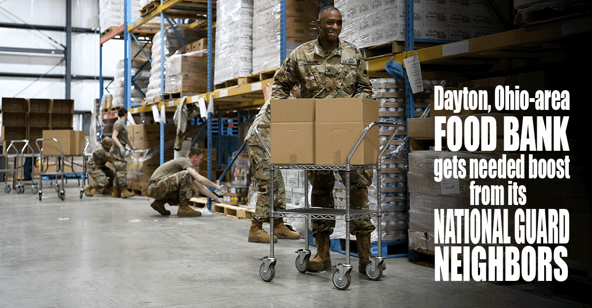 Soldiers working in food pantry warehouse.