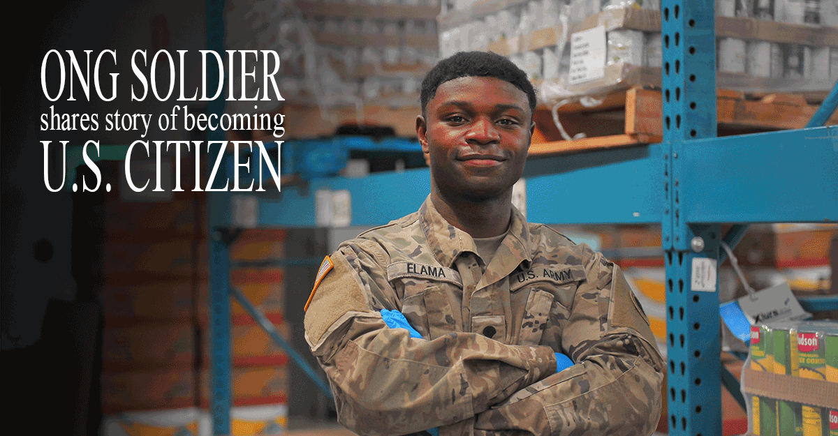Spc. Jacque Elama stands in warehouse