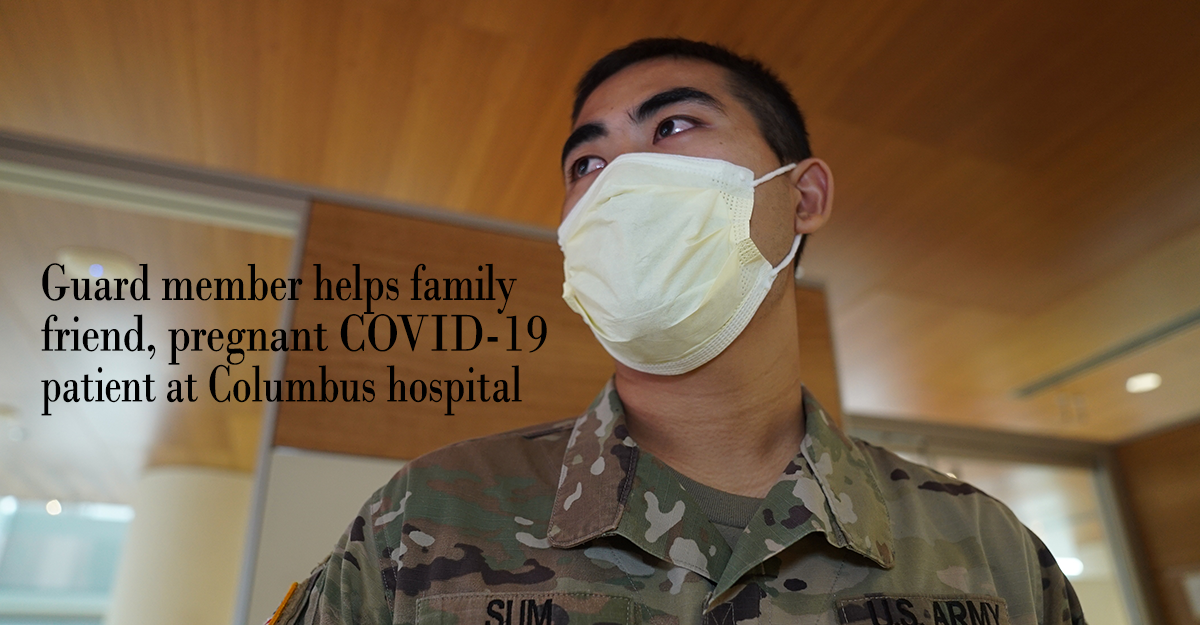 Head shot of Pfc. Dal Sum with mask in hospital lobby