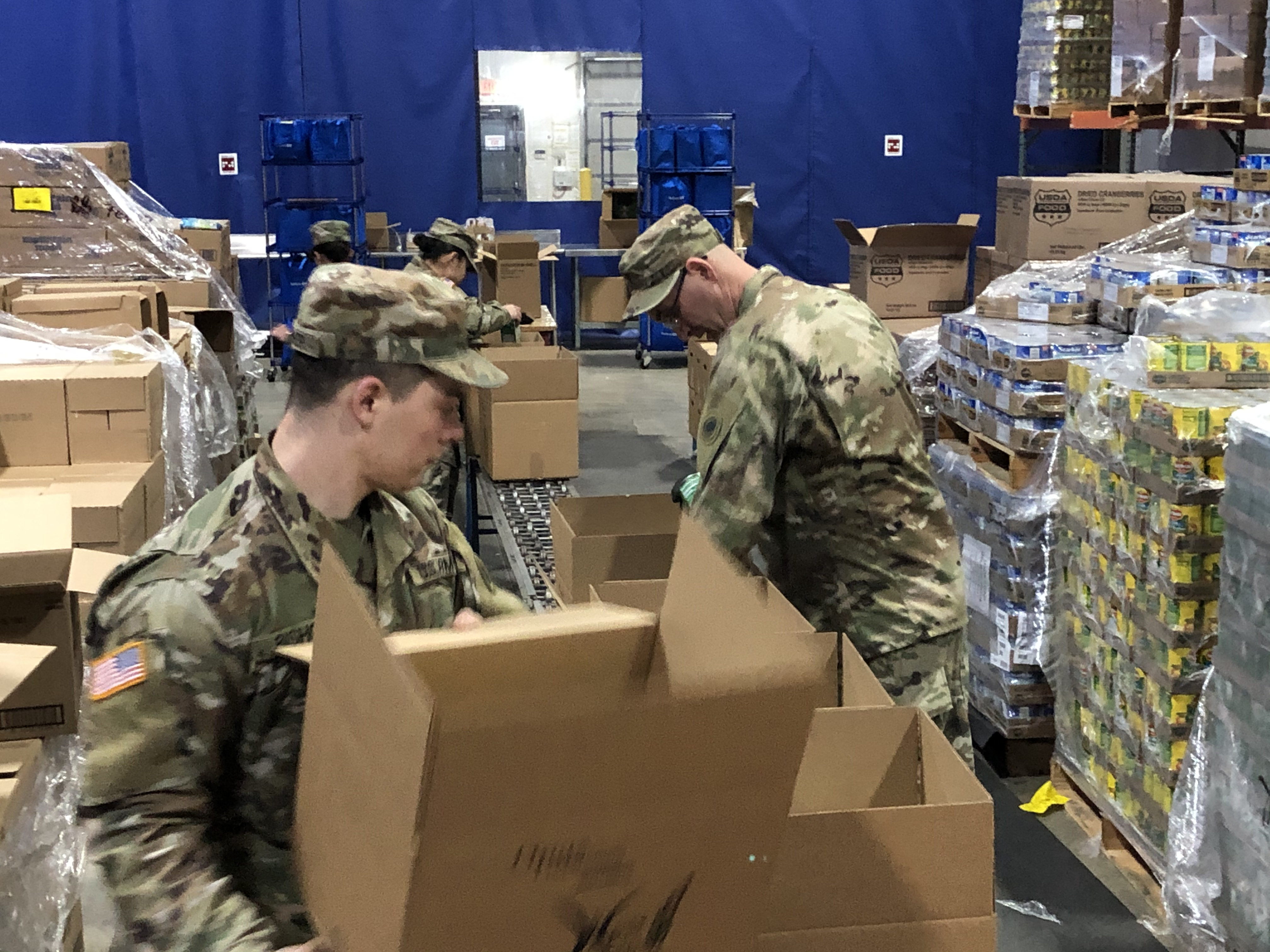 Soldiers pack boxes.
