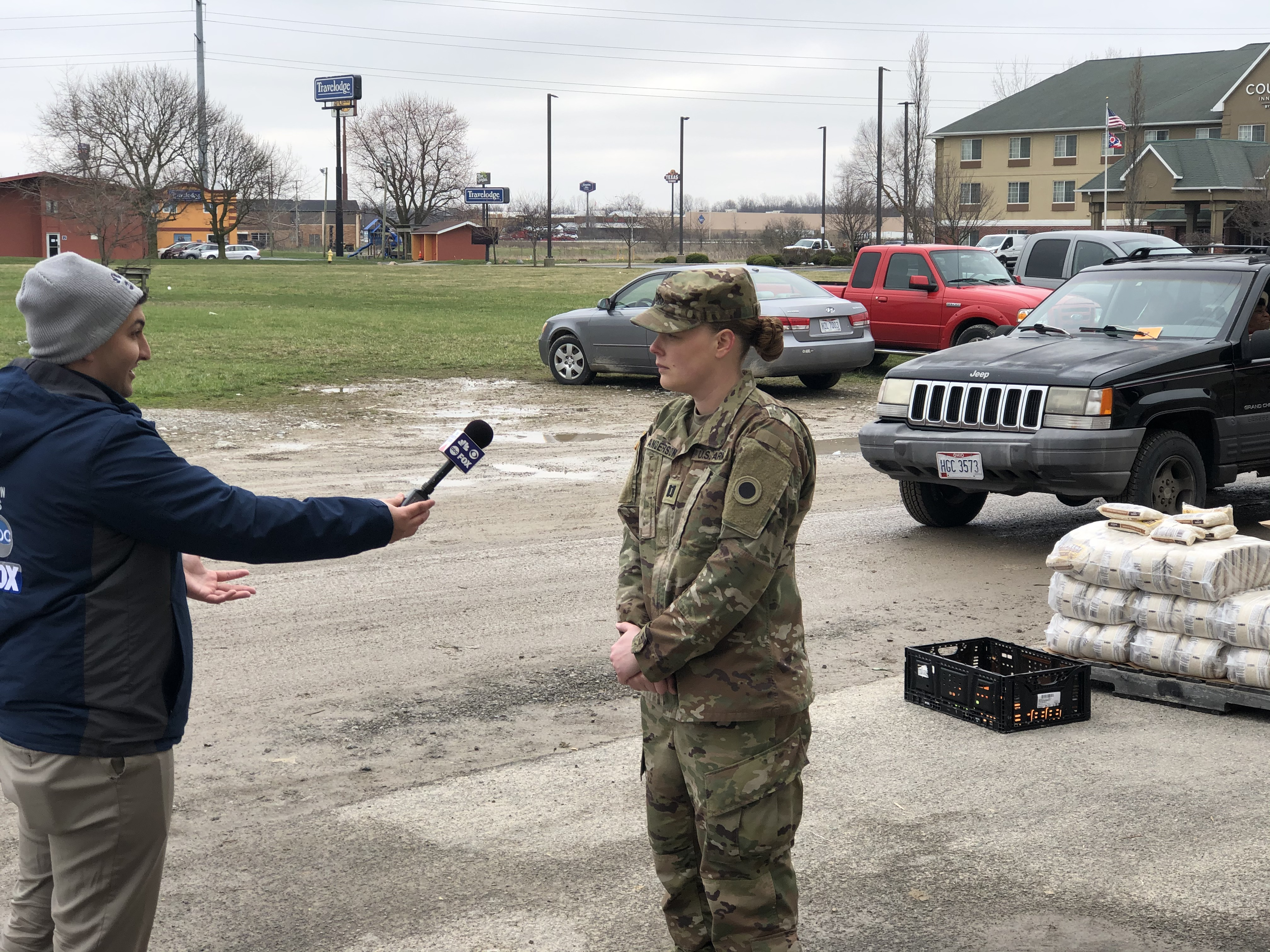 Soldier interviewed in parking lot.
