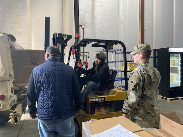 Soldier  moves pallets.