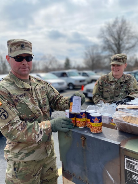 Soldier pulls canned goods.