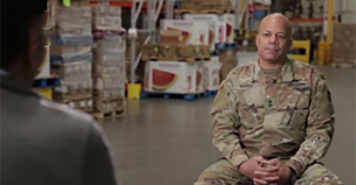 Maj. Gen. John C. Harris Jr. sits for interview at food pantry.